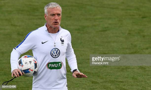 France's head coach Didier Deschamps reacts during a training session in Clairefontaine en Yvelines on May 26 as part of the team's preparation for...