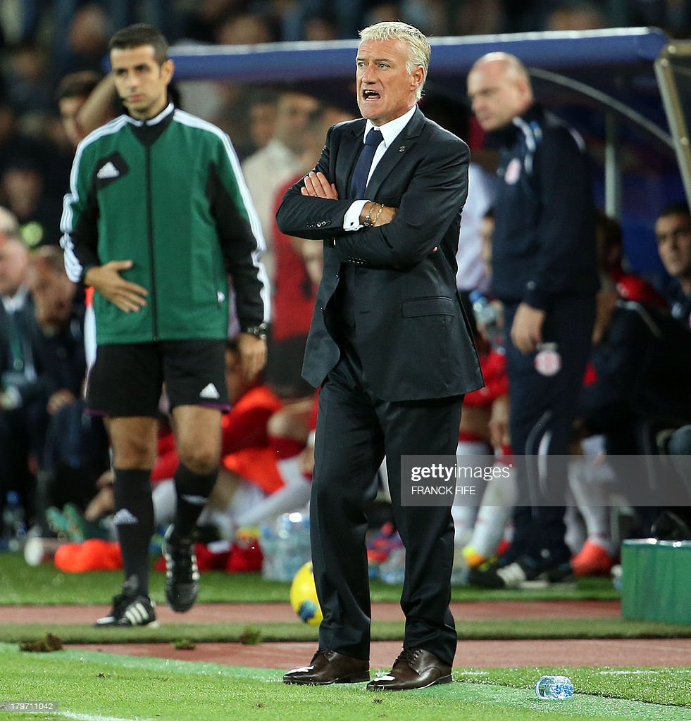 France's head coach Didier Deschamps (R) reacts during the FIFA World Cup 2014 qualifying football match Georgia vs France on September 6 2013 at the Boris Paichadze stadium in Tbilisi.