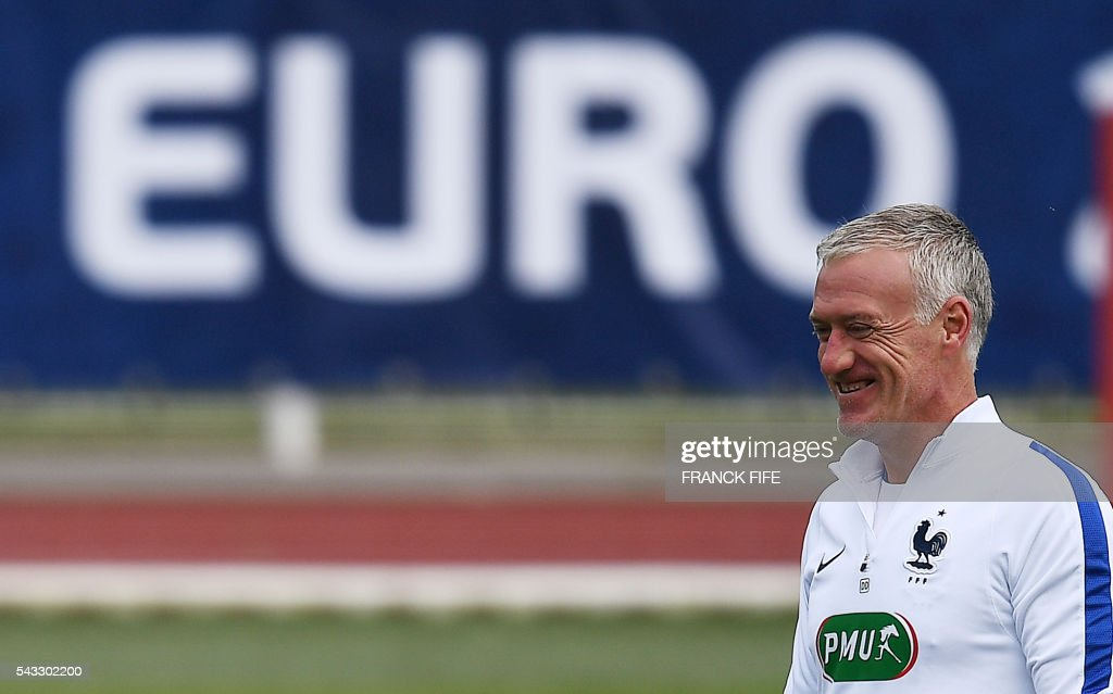 France's head coach Didier Deschamps smiles during a training session in Clairefontaine-en-Yvelines, southwest of Paris, on June 6, 2016, during the Euro 2016 football tournament. / AFP / FRANCK