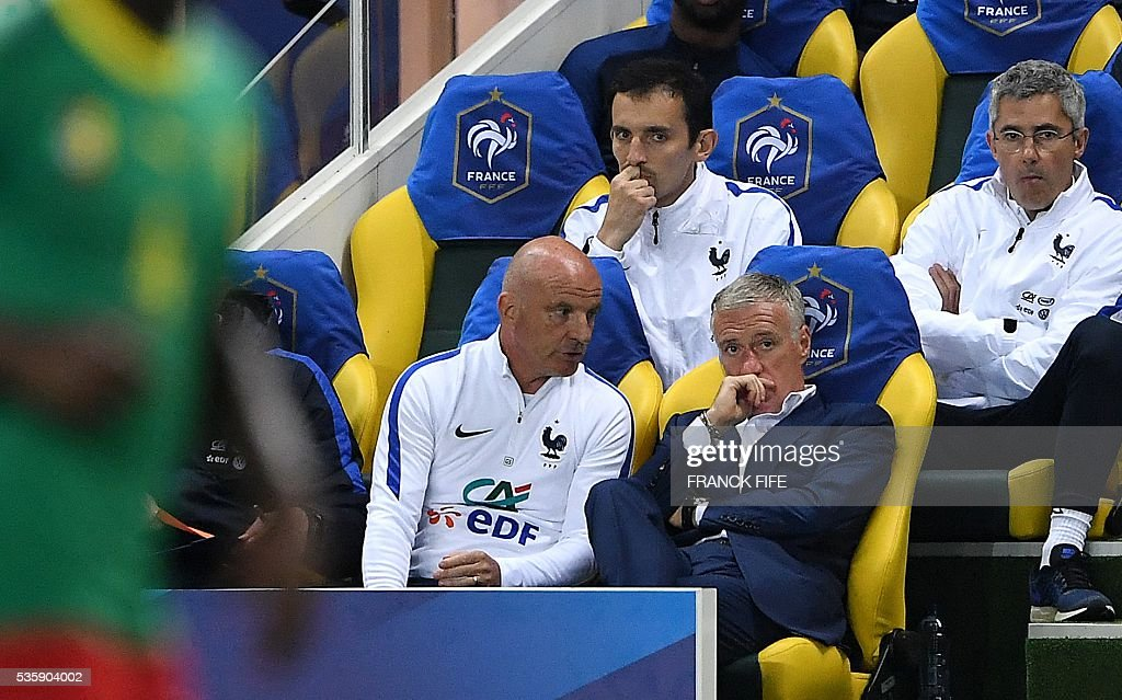 France's head coach Didier Deschamps (R) speaks with assistant coach Guy Stephan (L) during the International friendly football match between France and Cameroon at the Beaujoire stadium, in Nantes, western France, on May 30, 2016 as part of the French team's preparation for the upcoming Euro 2016 European football championships. / AFP / FRANCK