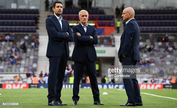 France's head coach Didier Deschamps speaks with assistant coach Guy Stephan and goalkeapers' coach Franck Raviot before the FIFA World Cup 2018...