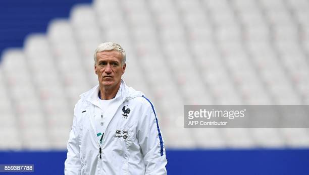 France's head coach Didier Deschamps supervises a training session at the Stade de France stadium in SaintDenis north of Paris on the eve of the...