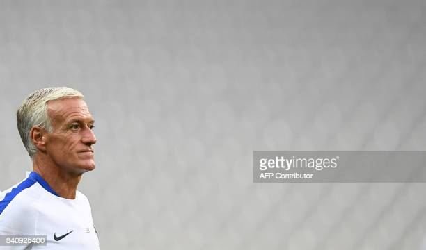 France's head coach Didier Deschamps supervises a training session on August 30 2017 at the Stade de France stadium in SaintDenis north of Paris on...