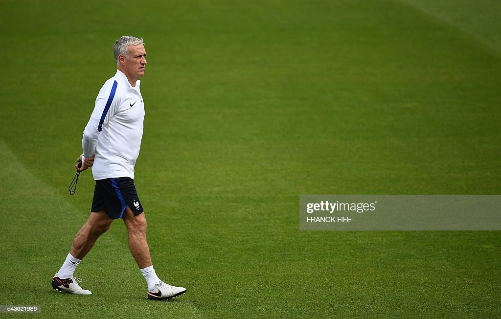 France's head coach Didier Deschamps walks on the picth during a training session in Clairefontaine-en-Yvelines, southwest of Paris, on June 29, 2016, during the Euro 2016 football tournament. / AFP / FRANCK