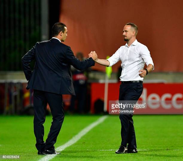France's head coach Olivier Echouafni and England's head coach Mark Sampson shake hands after the UEFA Women's Euro 2017 tournament quarterfinal...