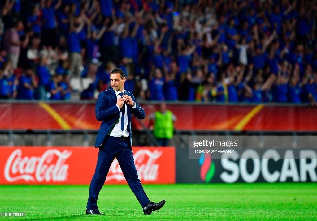 France's head coach Olivier Echouafni leaves the pitch after the UEFA Women's Euro 2017 football tournament match between France and Iceland at Stadium Koning Wilhelm II in Tilburg on July 18, 2017. /