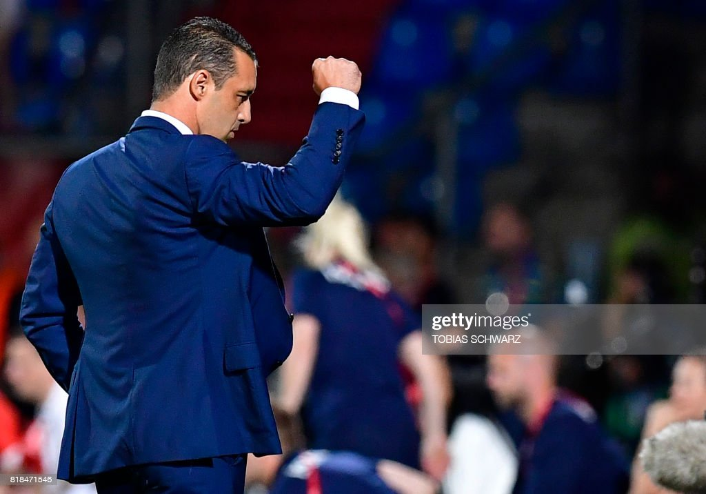 France's head coach Olivier Echouafni reacts after the UEFA Women's Euro 2017 football tournament match between France and Iceland at Stadium Koning Wilhelm II in Tilburg on July 18, 2017. /