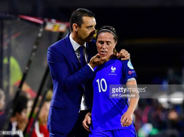 France's head coach Olivier Echouafni talks to France's midfielder Abily Camille during the UEFA Women's Euro 2017 football tournament between...