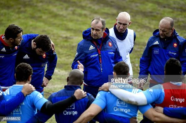 France's head coach Philippe Saint Andre flanked by France's assistant coach Patrice Lagisquet and France's assistant coach Yannick Bru directs his...