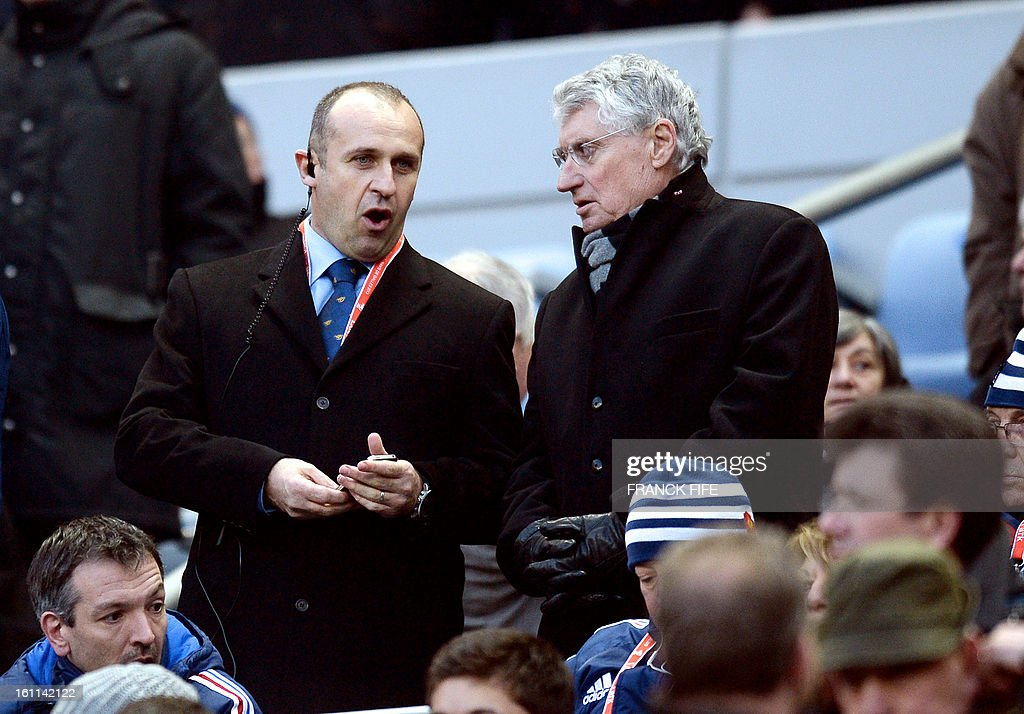 France's head coach Philippe Saint Andre (L) is pictured before the Six Nations Rugby Union match between France and Wales at the Stade de France on February 9, 2013 in Saint-Denis, north of Paris.