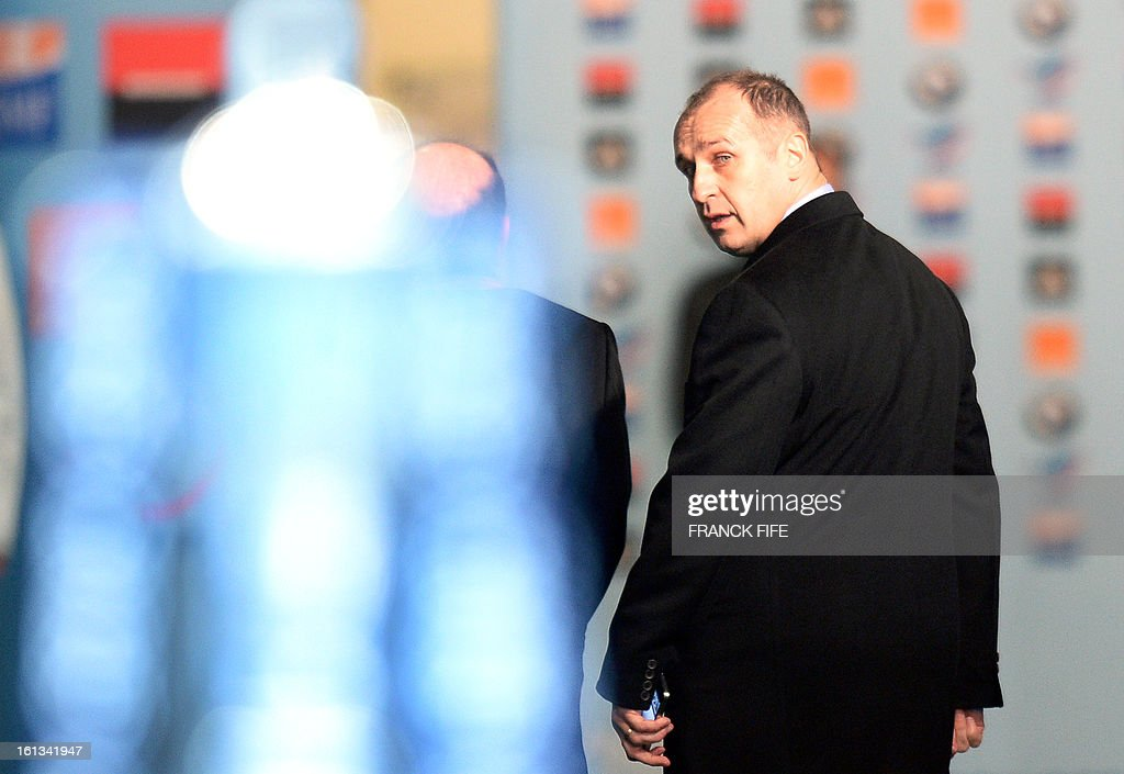 France's head coach Philippe Saint Andre leaves a pitch after the Six Nations Rugby Union match between France and Wales at the Stade de France on February 9, 2013 in Saint-Denis, north of Paris.