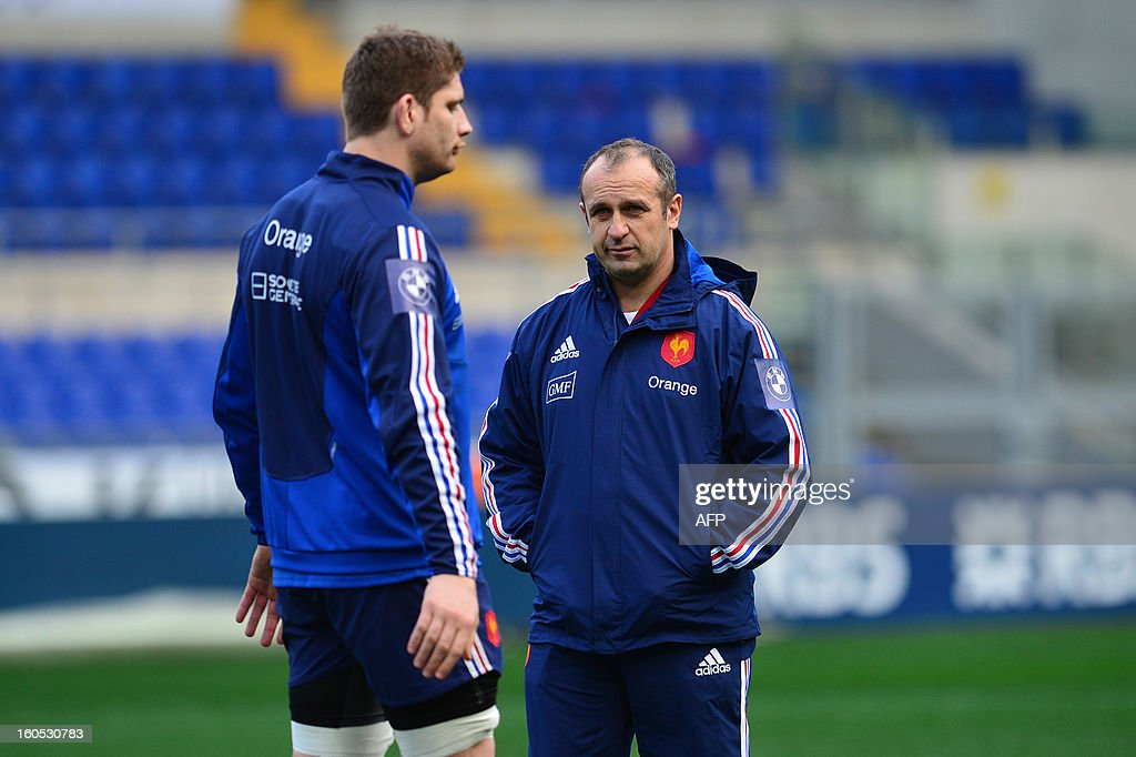 France's head coach Philippe Saint-Andre looks at France's lock and captain Pascal Pape (L) during the captain's run on the eve of the Six Nations International Rugby Union match between Italy and France at the Olympic Stadium in Rome on February 2, 2013. AFP PHOTO / GABRIEL BOUYS