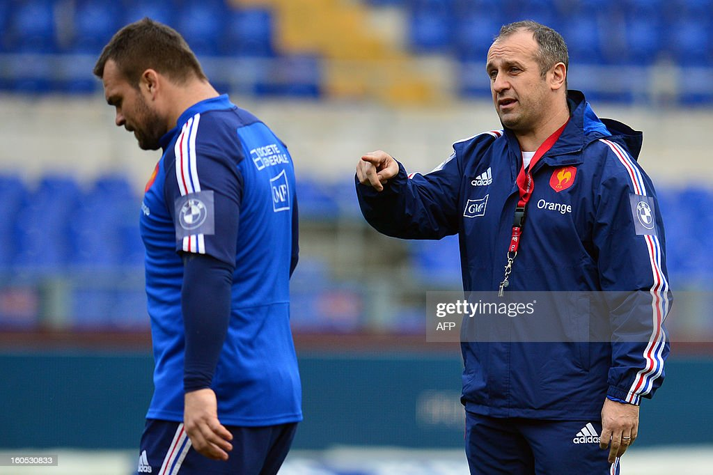 France's head coach Philippe Saint-Andre speaks to France's prop Nicolas Mas (L) during the captain's run on the eve of the Six Nations International Rugby Union match between Italy and France at the Olympic Stadium in Rome on February 2, 2013.