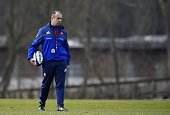 France's head coach Philippe SaintAndre walks on the field during a training session on March 13 2015 in Marcoussis south of Paris ahead of their Six...