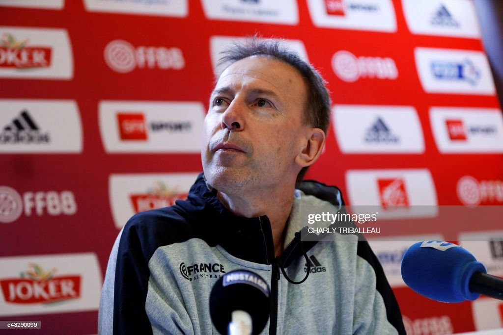 France's head coach Vincent Collet looks on during a press conference on June 27, 2016 in Rouen, northwestern France a day before the basketball match between France and Japan. / AFP / CHARLY
