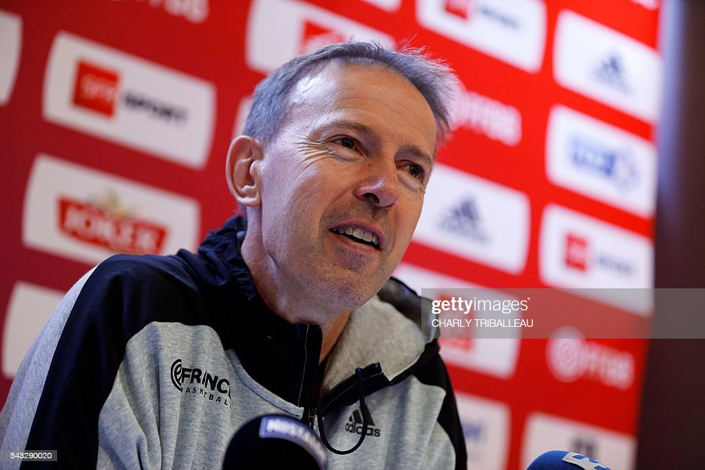 France's head coach Vincent Collet speaks during a press conference on June 27, 2016 in Rouen, northwestern France a day before the basketball match between France and Japan. / AFP / CHARLY