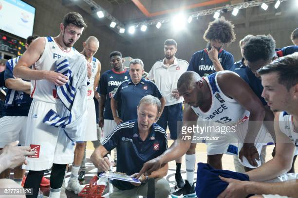 France's head coach Vincent Collet speaks to France's team during the friendly basketball match France versus Croatia ahead of the FIBA EuroBasket...