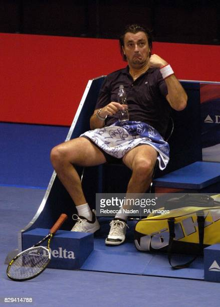 France's Henri Leconte has some fun with the crowd during the Masters tennis tournament at the Royal Albert Hall London