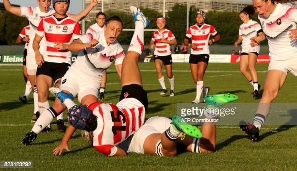France's hooker and captain Gaëlle Mignot reacts as France's flanker Romane Menager scores the opening try during the Women's Rugby World Cup 2017...