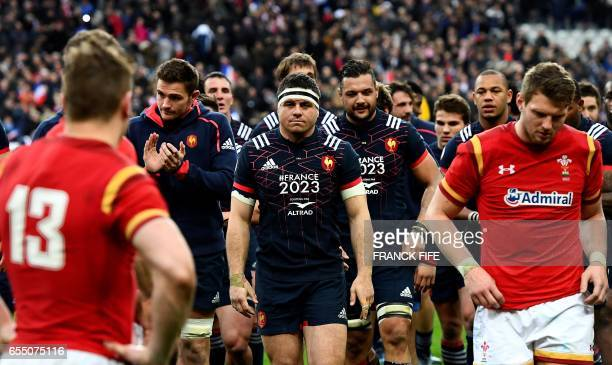 Frances hooker and captain Guilhem Guirado and Frances N°8 Damien Chouly react at the end of the Six Nations international rugby union match between...