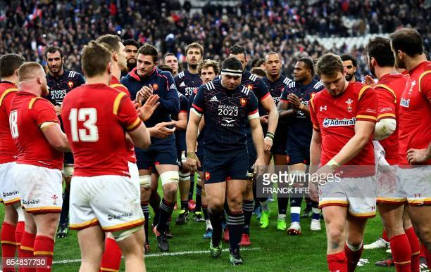 Frances hooker and captain Guilhem Guirado and his teammates leave the pitch at the end of the Six Nations tournament Rugby Union match between...