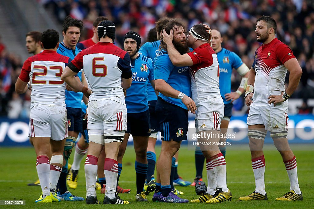 France's hooker and captain Guilhem Guirado (2nd R) and Italy's prop Martin Castrogiovanni (3rd R) embrace after the Six Nations international rugby union match between France and Italy at the Stade de France in Saint-Denis, north of Paris, on February 6, 2016. AFP PHOTO / THOMAS SAMSON / AFP / THOMAS SAMSON