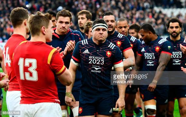 Frances hooker and captain Guilhem Guirado reacts at the end of the Six Nations tournament Rugby Union match between France and Wales at the Stade de...