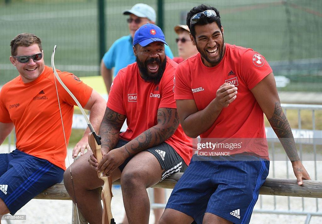 France's hooker Benjamin Kayser centre Mathieu Bastareaud and lock Sebastien Vahaamahina laugh as they joke during an archery session as part of the...