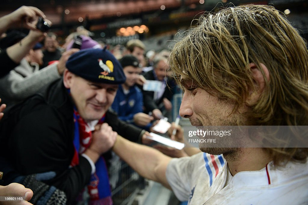 France's hooker Dimitri Szarzewski (R) is congratuled by supporters at the end of a rugby union test match against Samoa on November 24, 2012 at the Stade de France in the northern Paris suburb of Saint-Denis. FIFE