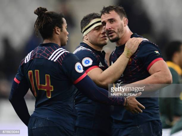 France's hooker Guilhem Guirado France's wing Teddy Thomas and France's number eight Louis Picamoles react after defeat in the friendly rugby union...