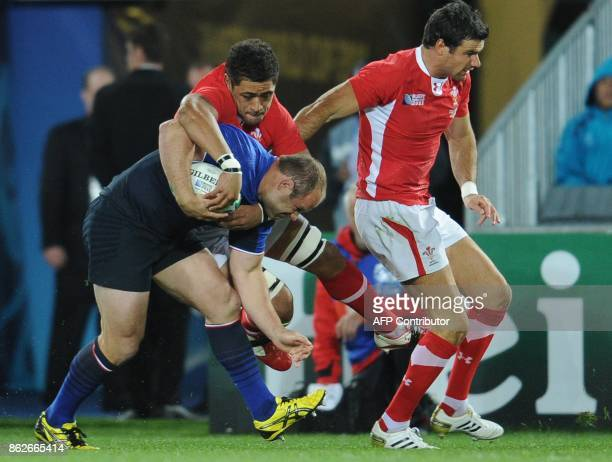 France's hooker William Servat vies with Wales' No8 Toby Faletau and Wales' scrumhalf Mike Phillips during the 2011 Rugby World Cup semifianl match...