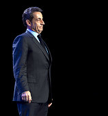 France's incumbent president and Union for a Popular Movement party candidate for the French 2012 presidential election Nicolas Sarkozy stands on...