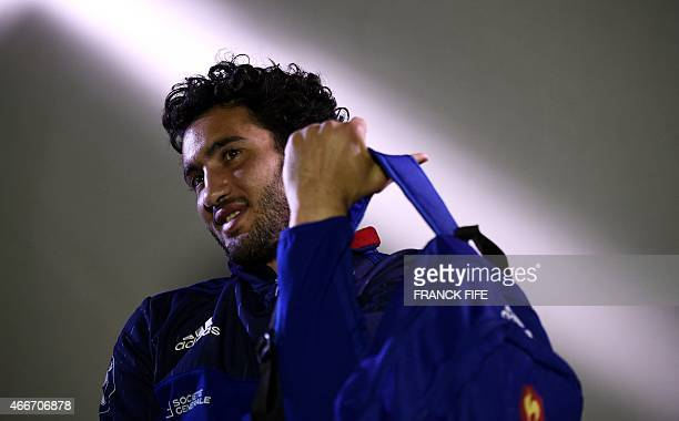 France's inside centre Maxime Mermoz leaves after a press conference in Marcoussis south of Paris on March 18 2015 ahead of the Six Nations rugby...