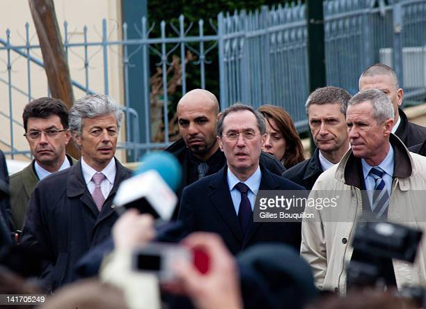 France's Interior Minister Claude Gueant speaks as Paris' prosecutor Francois Molins looks on after an operation to arrest suspected gunman Mohammed...