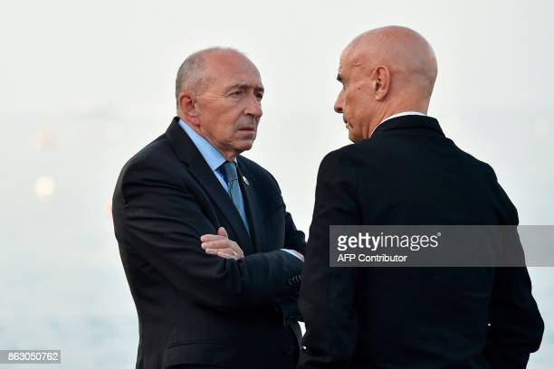 France's Interior Minister Gerard Collomb speaks with Italy's Interior Minister Marco Minniti as he arrives on October 19 2017 at the Aragonese...