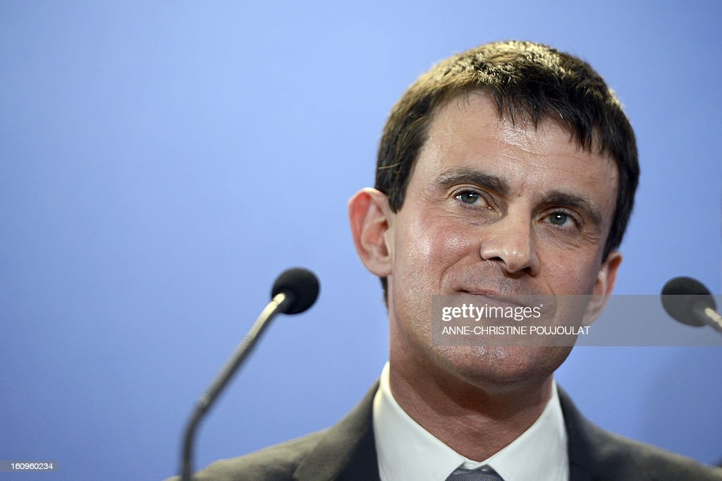 France's Interior Minister Manuel Valls during the inauguration of the Urban Supervision Centre (CSU) on February 8, 2013 in Marseille, southern France. AFP PHOTO / ANNE-CHRISTINE POUJOULAT
