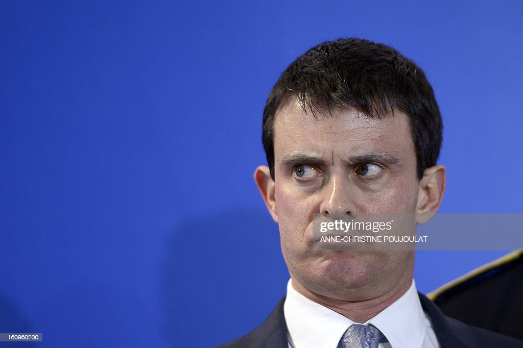 France's Interior Minister Manuel Valls grimaces before speaking as part of the inauguration of the Urban Supervision Centre (CSU) on February 8, 2013 in Marseille, southern France.
