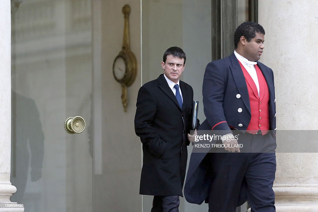 France's Interior minister Manuel Valls leaves the Elysee presidential Palace on January 18, 2013 in Paris after attending a fifth Defence Council since French forces back the Malian army against Islamist rebels.