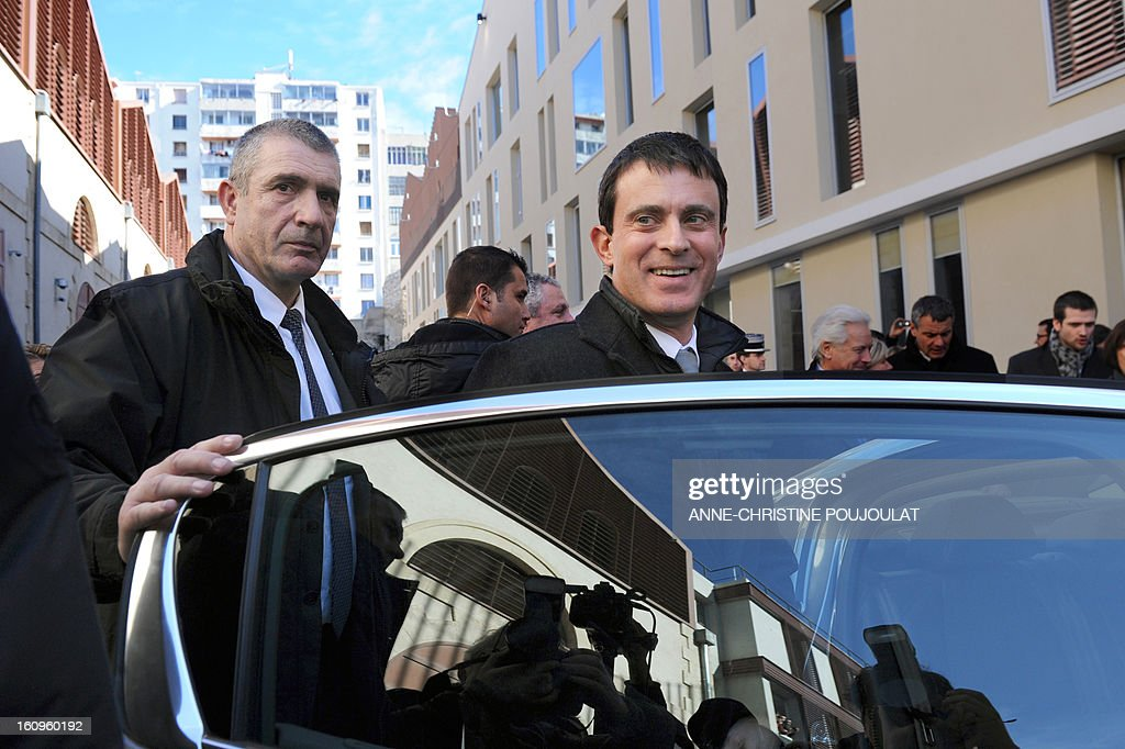 France's Interior Minister Manuel Valls leaves the Urban Supervision Centre (CSU) after it inauguration, on February 8, 2013 in Marseille, southern France.