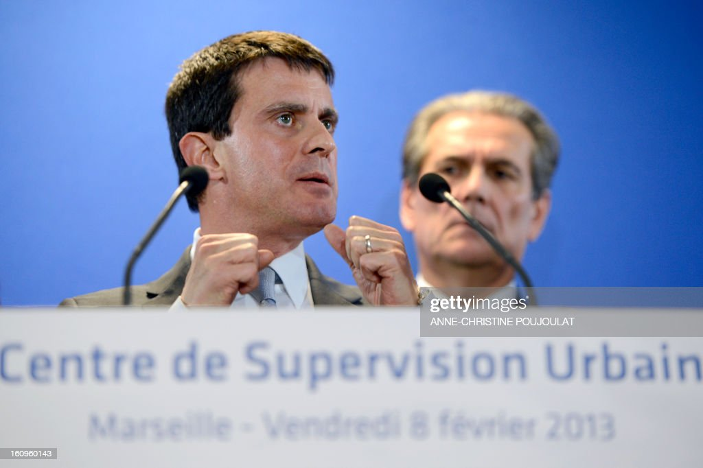 France's Interior Minister Manuel Valls (L) speaks next to Bouches-du-Rhone's prefect Jean-Paul Bonnetain (R) during the inauguration of the Urban Supervision Centre (CSU) on February 8, 2013 in Marseille, southern France.