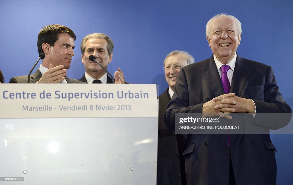 France's Interior Minister Manuel Valls (L) speaks next to Marseille's mayor Jean-Claude Gaudin (R) during the inauguration of the Urban Supervision Centre (CSU) on February 8, 2013 in Marseille, southern France.