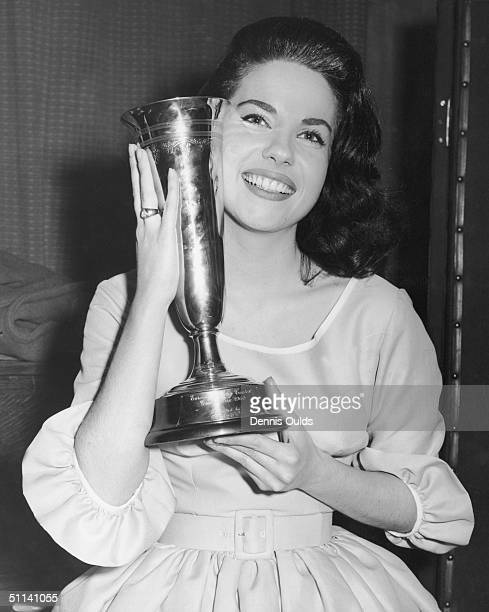 France's Jacqueline Boyer clutches her trophy after winning the Eurovision Song Contest at the Royal Festival Hall with her song 'Tom Pillibi' 30th...