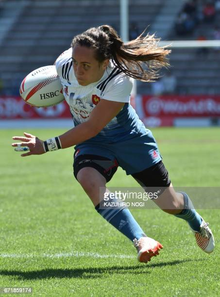France's Jade Le Pesq runs with the ball against Russia during their fifth place semifinals at the World Rugby Women's Seven Series in Kitakyushu...