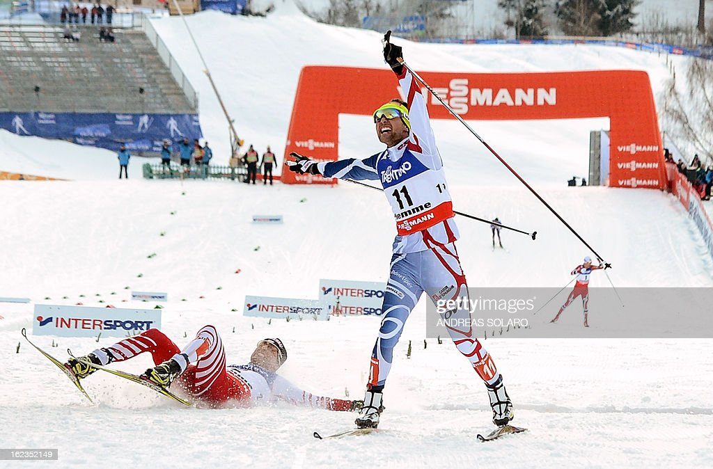 France's Jason Lamy Chappuis (C) celebrates as he crosses the finish line ahead of Austria's Mario Stecher (L) of the men's cross country 10 km race of the Nordic Combined Individual Gundersen as part of the Val di Fiemme FIS Nordic World ski championships in Cavalese, northern Italy on February 22, 2013.