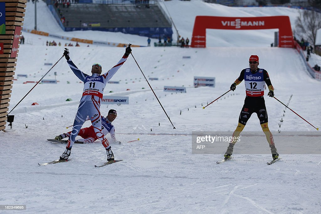 France's Jason Lamy Chappuis (foreground L) celebrates his victory next to Germany's Bjoern Kircheisen (R) as he crosses the finish line of the men's cross country 10 km race of the Nordic Combined Individual Gundersen as part of the Val di Fiemme FIS Nordic World ski championships in Cavalese, north Italy on February 22, 2013.