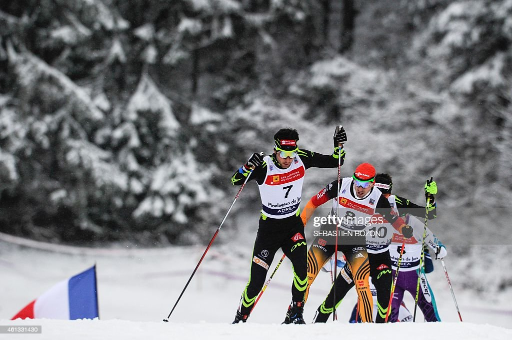 France's Jason Lamy Chappuis (C) competes ahead (from L to R) Germany's Bjoern Kircheisen, France's Francois Braud and Japan's Taihei Kato during the skiing race during the individual Gundersen of the FIS Nordic Combined World Cup, on January 11, 2015 in Chaux-Neuve, eastern France.