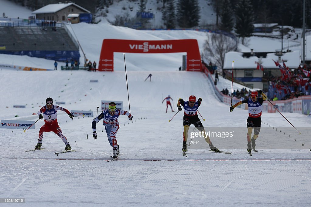 France's Jason Lamy Chappuis (2ndL) crosses the finish line ahead of (LtoR) Austria's Mario Stecher and Germany's Bjoern Kircheisen and Eric Frenzel at the end of the men's cross country 10 km race of the Nordic Combined Individual Gundersen as part of the Val di Fiemme FIS Nordic World ski championships in Cavalese, north Italy on February 22, 2013.
