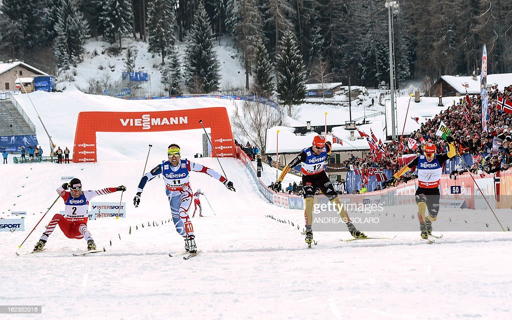France's Jason Lamy Chappuis (2nd L) crosses the finish line ahead of (from L) Austria's Mario Stecher, Germany's Bjoern Kircheisen and Eric Frenzel at the end of the men's cross country 10 km race of the Nordic Combined Individual Gundersen as part of the Val di Fiemme FIS Nordic World ski championships in Cavalese, north Italy on February 22, 2013. AFP PHOTO / ANDREAS SOLARO