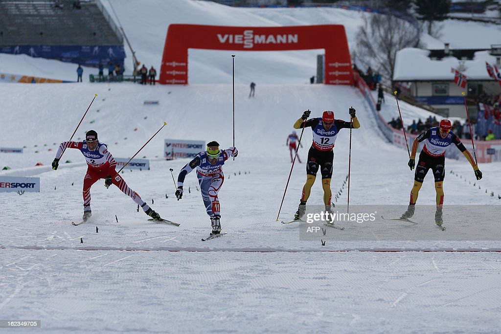 France's Jason Lamy Chappuis (2ndL) is about to cross the finish line ahead of (LtoR) Austria's Mario Stecher and Germany's Bjoern Kircheisen and Eric Frenzel at the end of the men's cross country 10 km race of the Nordic Combined Individual Gundersen as part of the Val di Fiemme FIS Nordic World ski championships in Cavalese, north Italy on February 22, 2013.