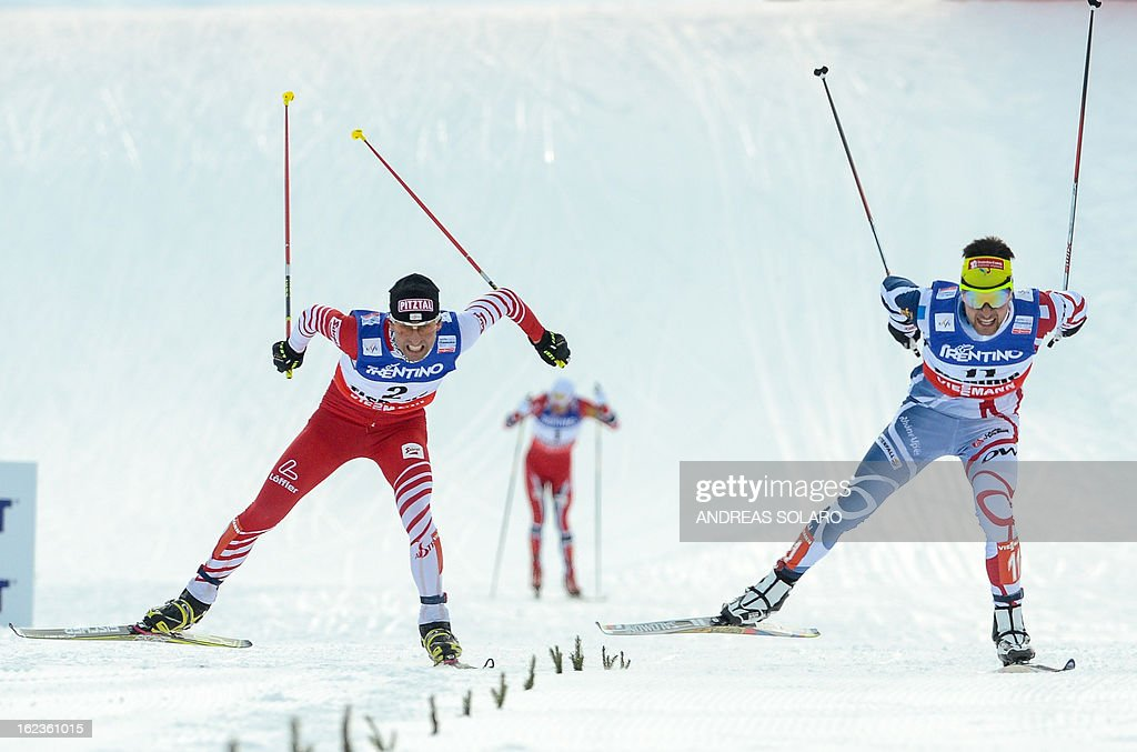 France's Jason Lamy Chappuis (R) races to cross the finish line ahead of Austria's Mario Stecher during the men's cross country 10 km race of the Nordic Combined Individual Gundersen event of the Val di Fiemme FIS Nordic World ski championships on February 22, 2013 in Cavalese, northern Italy.